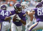MIAMI GARDENS, FL - DECEMBER 21:  Quarterback Teddy Bridgewater #5 of the Minnesota Vikings looks for a receiver in the first quarter during a game against the Miami Dolphins at Sun Life Stadium on December 21, 2014 in Miami Gardens, Florida.  (Photo by Mike Ehrmann/Getty Images)