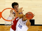 INDIANAPOLIS, IN - APRIL 04: Karl-Anthony Towns #12 of the Kentucky Wildcats drives to the basket against Frank Kaminsky #44 of the Wisconsin Badgers in the second half during the NCAA Men's Final Four Semifinal at Lucas Oil Stadium on April 4, 2015 in Indianapolis, Indiana.  (Photo by Andy Lyons/Getty Images)