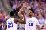 INDIANAPOLIS, IN - APRIL 06: Amile Jefferson #21 and Jahlil Okafor #15 of the Duke Blue Devils react after a play in the first half against the Wisconsin Badgers during the NCAA Men's Final Four National Championship at Lucas Oil Stadium on April 6, 2015 in Indianapolis, Indiana.  (Photo by Streeter Lecka/Getty Images)