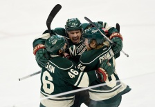 ST PAUL, MN - APRIL 26: Zach Parise #11 of the Minnesota Wild celebrates scoring a short-handed goal against the St. Louis Blues with teammate Jared Spurgeon #46 and Mikael Granlund #64 during the first period in Game Six of the Western Conference Quarterfinals during the 2015 NHL Stanley Cup Playoffs on April 26, 2015 at Xcel Energy Center in St Paul, Minnesota. (Photo by Hannah Foslien/Getty Images)