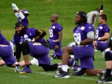 EDEN PRAIRIE, MN - JUNE 4: Adrian Peterson #28 of the Minnesota Vikings stretches during practice on June 4, 2015 at Winter Park in Eden Prairie, Minnesota. (Photo by Hannah Foslien/Getty Images)