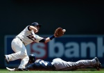 MINNEAPOLIS, MN - JUNE 6: Carlos Gomez #27 of the Milwaukee Brewers steals second base as Brian Dozier #2 of the Minnesota Twins fields the ball during the first inning of the game on June 6, 2015 at Target Field in Minneapolis, Minnesota. (Photo by Hannah Foslien/Getty Images)