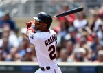 MINNEAPOLIS, MN - JUNE 7: Eddie Rosario #20 of the Minnesota Twins hits an RBI triple against the Milwaukee Brewers during the second inning of the game on June 7, 2015 at Target Field in Minneapolis, Minnesota. (Photo by Hannah Foslien/Getty Images)