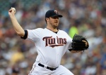 MINNEAPOLIS, MN - JUNE 19: Phil Hughes #45 of the Minnesota Twins delivers a pitch against the Chicago Cubs during the first inning of the game on June 19, 2015 at Target Field in Minneapolis, Minnesota. (Photo by Hannah Foslien/Getty Images)