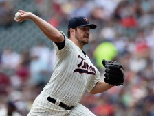 MINNEAPOLIS, MN - JUNE 24: Phil Hughes #45 of the Minnesota Twins delivers a pitch against the Chicago White Sox during the second inning of the game on June 24, 2015 at Target Field in Minneapolis, Minnesota. (Photo by Hannah Foslien/Getty Images)
