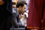 INDIANAPOLIS, IN - MARCH 14:  Richard Pitino the head coach of the Minnesota Golden Gophers gives instructions to his team in the game against the Wisconsin Badgers during the Quarterfinals of the Big Ten Basketball Tournament at Bankers Life Fieldhouse on March 14, 2014 in Indianapolis, Indiana.  (Photo by Andy Lyons/Getty Images)