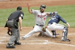 MILWAUKEE, WI - JUNE 28: Joe Mauer #7 of the Minnesota Twins beats the tag from Jonathan Lucroy #20 of the Milwaukee Brewers after reaching on a sacrifice fly hit by Eduardo Escobar in the seventh inning during the Interleague game at Miller Park on June 28, 2015 in Milwaukee, Wisconsin. (Photo by Mike McGinnis/Getty Images)