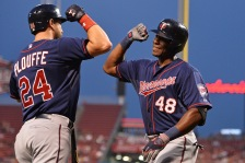 CINCINNATI, OH - JUNE 30:  Trevor Plouffe #24 of the Minnesota Twins celebrates with Torii Hunter #48 of the Minnesota Twins after Hunter hit a first inning solo home run against the Cincinnati Reds at Great American Ball Park on June 30, 2015 in Cincinnati, Ohio.  (Photo by Jamie Sabau/Getty Images)