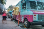 A funny and colorful food truck setting up for business in the afternoon. Food trucks serving refreshing food for reasonable prices are becoming popular in Miami Beach and other cities by the sea in Florida, as an alternative to neighbors and tourist.