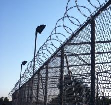 iStock OK TO REUSE _jail-prison-fence-barbed-wire-crop