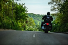 motorbike rider at speed on a highway. Behind view.