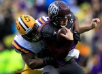 BATON ROUGE, LA - NOVEMBER 23:  Quarterback Johnny Manziel #2 of the Texas A&M Aggies is sacked by defensive end Danielle Hunter #94 of the LSU Tigers at Tiger Stadium on November 23, 2013 in Baton Rouge, Louisiana.  (Photo by Sean Gardner/Getty Images)