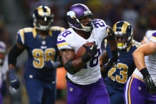 ST. LOUIS, MO - SEPTEMBER 7: Adrian Peterson #28 of the Minnesota Vikings runs up field against the St. Louis Rams at the Edward Jones Dome on September 7, 2014 in St. Louis, Missouri.  (Photo by Dilip Vishwanat/Getty Images)