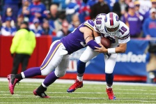 ORCHARD PARK, NY - OCTOBER 19:  Brian Robison #96 of the Minnesota Vikings sacks Kyle Orton #18 of the Buffalo Bills during the first half at Ralph Wilson Stadium on October 19, 2014 in Orchard Park, New York.  (Photo by Brett Carlsen/Getty Images)