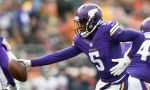 MINNEAPOLIS, MN - DECEMBER 28: Teddy Bridgewater #5 of the Minnesota Vikings looks to hand off the ball against the Chicago Bears during the second quarter of the game on December 28, 2014 at TCF Bank Stadium in Minneapolis, Minnesota. (Photo by Hannah Foslien/Getty Images)