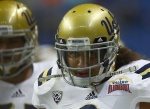 SAN ANTONIO, TX - JANUARY 02:  Eric Kendricks #6 of the UCLA Bruins warms up before a game against the Kansas State Wildcats during the Valero Alamo Bowl at Alamodome on January 2, 2015 in San Antonio, Texas.  (Photo by Ronald Martinez/Getty Images)