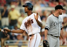 MINNEAPOLIS, MN - JUNE 22: Byron Buxton #25 of the Minnesota Twins celebrates scoring a run as John Danks #50 of the Chicago White Sox looks on during the first inning of the game on June 22, 2015 at Target Field in Minneapolis, Minnesota. (Photo by Hannah Foslien/Getty Images)