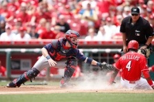 CINCINNATI, OH - JULY 1: Brandon Phillips #4 of the Cincinnati Reds scores ahead of the tag by Chris Herrmann #12 of the Minnesota Twins after a sacrifice fly by Joey Votto in the third inning at Great American Ball Park on July 1, 2015 in Cincinnati, Ohio. (Photo by Joe Robbins/Getty Images)
