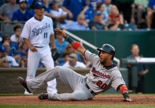 KANSAS CITY, MO - JULY 3:  Eddie Rosario #20 of the Minnesota Twins slides across home to score against the Kansas City Royals in the second inning at Kauffman Stadium on July 3, 2015 in Kansas City, Missouri. (Photo by Ed Zurga/Getty Images)
