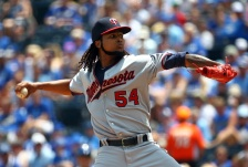 KANSAS CITY, MO - JULY 05:  Starting pitcher Ervin Santana #54 of the Minnesota Twins pitches during the 1st inning of the game against the Kansas City Royals at Kauffman Stadium on July 5, 2015 in Kansas City, Missouri.  (Photo by Jamie Squire/Getty Images)