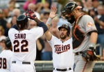 MINNEAPOLIS, MN - JULY 7: Trevor Plouffe #24 of the Minnesota Twins congratulates teammate Miguel Sano #22 on a two-run home run as Matt Wieters #32 of the Baltimore Orioles looks on during the first inning of the game on July 7, 2015 at Target Field in Minneapolis, Minnesota. (Photo by Hannah Foslien/Getty Images)