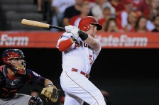 ANAHEIM, CA - JULY 22:  Kole Calhoun #56 of the Los Angeles Angels of Anaheim follows through on an RBI single in the thrid inning during a game against the Minnesota Twins at Angel Stadium of Anaheim on July 22, 2015 in Anaheim, California.  (Photo by Jonathan Moore/Getty Images)