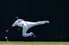 MINNEAPOLIS, MN - JULY 26: Torii Hunter #48 of the Minnesota Twins is unable to catch a ball hit by Carlos Beltran of the New York Yankees in right field during the second inning of the game on July 26, 2015 at Target Field in Minneapolis, Minnesota. (Photo by Hannah Foslien/Getty Images)