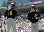 MINNEAPOLIS, MN - JULY 29: Neil Walker #18 of the Pittsburgh Pirates congratulates teammate Jung Ho Kang #27 on a solo home run against the Minnesota Twins during the second inning of the game on July 29, 2015 at Target Field in Minneapolis, Minnesota. (Photo by Hannah Foslien/Getty Images)