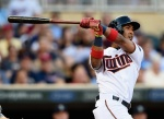 MINNEAPOLIS, MN - JULY 30: Eddie Rosario #20 of the Minnesota Twins hits a three-run home run against the Seattle Mariners during the first inning of the game on July 30, 2015 at Target Field in Minneapolis, Minnesota. (Photo by Hannah Foslien/Getty Images)