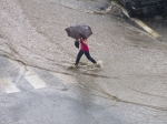 iStock_flooding-roadway-storm-rain-umbrella