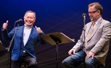 Wits host John Moe, right, with guest George Takei during a live broadcast on June 18, 2015.