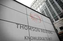 A new signboard is displayed at the Thomson Reuters building in Canary Wharf in London, on April 17, 2008. Thomson Reuters Corp launched on the London stock market on Thursday, creating the world's biggest provider of financial data to trading floors and overtaking US rival Bloomberg. Thomson Reuters was formed after Canada's Thomson Corp bought British-based media and information group Reuters for 8.7 billion pounds (11.5 billion euros, 17 billion dollars) in a deal which was completed on Thursday.AFP PHOTO/SHUAN CURRY (Photo credit should read SHAUN CURRY/AFP/Getty Images)