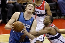 WASHINGTON, DC - JANUARY 25: A.J. Price #12 of the Washington Wizards fouls Andrei Kirilenko #47 of the Minnesota Timberwolves during the first half at Verizon Center on January 25, 2013 in Washington, DC. NOTE TO USER: User expressly acknowledges and agrees that, by downloading and or using this photograph, User is consenting to the terms and conditions of the Getty Images License Agreement.  (Photo by Rob Carr/Getty Images)