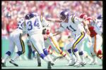 9 Sep 1990: Quarterback Wade Wilson of the Minnesota Vikings (right) hands the ball off to teammate running back Herschel Walker during a game against the Kansas City Chiefs at Arrowhead Stadium in Kansas City, Missouri. The Chiefs won the game, 24-21.