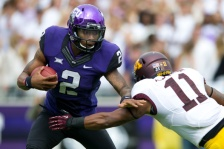 FORT WORTH, TX - SEPTEMBER 13:  Trevone Boykin #2 of the TCU Horned Frogs breaks a tackle from Antonio Johnson #11of the Minnesota Golden Gophers during the 1st quarter on September 13, 2014 at Amon G. Carter Stadium in Fort Worth, Texas.  (Photo by Cooper Neill/Getty Images)