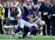 MINNEAPOLIS, MN - SEPTEMBER 14: Gerald Hodges #50 of the Minnesota Vikings tackles Rob Gronkowski #87 of the New England Patriots during the third quarter of the game on September 14, 2014 at TCF Bank Stadium in Minneapolis, Minnesota. The Patriots defeated the Vikings 30-7. (Photo by Hannah Foslien/Getty Images)