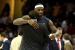 CLEVELAND, OH - DECEMBER 23: LeBron James #23 of the Cleveland Cavaliers hugs former teammate Mo Williams #25 of the Minnesota Timberwolves after their game at Quicken Loans Arena on December 23, 2014 in Cleveland, Ohio. NOTE TO USER: User expressly acknowledges and agrees that, by downloading and or using this photograph, User is consenting to the terms and conditions of the Getty Images License Agreement.  (Photo by Mike Lawrie/Getty Images)