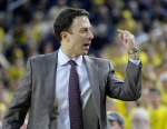 ANN ARBOR, MI - JANUARY 10:  Head coach Richard Pitino of the Minnesota Golden Gophers calls for a player from the bench during the second half of a game against the Michigan Wolverines at Crisler Arena on January 10, 2015 in Ann Arbor, Michigan. Michigan defeated Minnesota 62-57. (Photo by Duane Burleson/Getty Images)