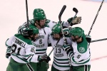 BOSTON, MA - APRIL 09:  Connor Gaarder #13 of North Dakota celebrates scoring his team's third goal against the Boston University Terriers in the third period during the 2015 NCAA Division I Men's Hockey Championship semifinals at TD Garden on April 9, 2015 in Boston, Massachusetts.  (Photo by Mike Lawrie/Getty Images)