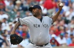 ARLINGTON, TX - JULY 30:  CC Sabathia #52 of the New York Yankees throws against the Texas Rangers in the second inning at Globe Life Park in Arlington on July 30, 2015 in Arlington, Texas.  (Photo by Ronald Martinez/Getty Images)