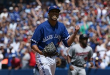 TORONTO, CANADA - AUGUST 3: David Price #14 of the Toronto Blue Jays reacts after striking out Kurt Suzuki #8 of the Minnesota Twins to end the fourth inning during MLB game action on August 3, 2015 at Rogers Centre in Toronto, Ontario, Canada. (Photo by Tom Szczerbowski/Getty Images)