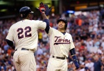 MINNEAPOLIS, MN - AUGUST 12:  Brian Dozier #2 of the Minnesota Twins congratulates teammate Miguel Sano #22 on a two-run home run against the Texas Rangers during the third inning of the game on August 12, 2015 at Target Field in Minneapolis, Minnesota. (Photo by Hannah Foslien/Getty Images)