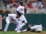 MINNEAPOLIS, MN - AUGUST 16: Brian Dozier #2 of the Minnesota Twins catches Francisco Lindor #12 of the Cleveland Indians stealing second base during the first inning of the game on August 16, 2015 at Target Field in Minneapolis, Minnesota. (Photo by Hannah Foslien/Getty Images)