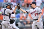 BALTIMORE, MD - AUGUST 23:  Kurt Suzuki #8 and Tommy Milone #33 of the Minnesota Twins celebrate a win after a baseball game against the Baltimore Orioles at Oriole Park at Camden Yards on August 23, 2015 in Baltimore, Maryland.  The Twins won 4-3 in the 12th inning.  (Photo by Mitchell Layton/Getty Images)