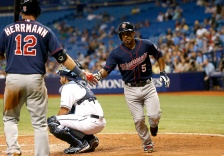 ST. PETERSBURG, FL - AUGUST 26:  Eduardo Escobar #5 of the Minnesota Twins celebrates with teammate Chris Herrmann #12 in front of catcher Rene Rivera #44 of the Tampa Bay Rays after hitting a home run during the sixth inning of a game on August 26, 2015 at Tropicana Field in St. Petersburg, Florida.  (Photo by Brian Blanco/Getty Images)