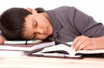 A student falls asleep at his desk