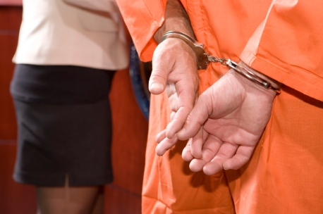 iStockPhoto OK TO REUSE handcuffs court charges