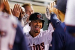 Minnesota Twins shortstop Eduardo Escobar (5) celebrates his home run against the Detroit Tigers in the fourth inning of a baseball game, Monday, Sept. 14, 2015, in Minneapolis. (AP Photo/Bruce Kluckhohn)