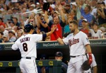 Minnesota Twins' Kurt Suzuki, left, is congratulated by Trevor Plouffe after scoring on a two-run double by Brian Dozier during the second inning of a baseball game against the Chicago White Sox, Tuesday, Sept. 1, 2015, in Minneapolis. (AP Photo/Jim Mone)