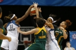 Minnesota Lynx forwards Rebekkah Brunson (32) and Maya Moore (23) fight for a rebound against Seattle Storm forwards Ramu Tokashiki (7) and Alysha Clark (32) during the first half of a WNBA basketball game, Tuesday, Sept. 8, 2015, in Minneapolis. (AP Photo/Stacy Bengs)